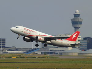 Air Arabia Maroc Airbus A320-214 takes off