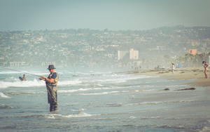 Man fishing in California beach