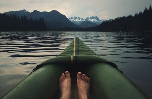 Man's feet in a canoe