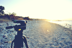 Camera tripod on a beach