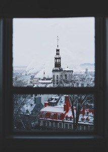 Window-view of snow-covered church