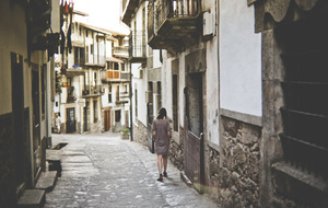 Woman walking in Candelario, Spain