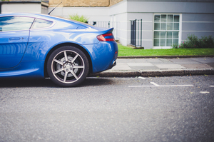 Blue sports car parked in the street