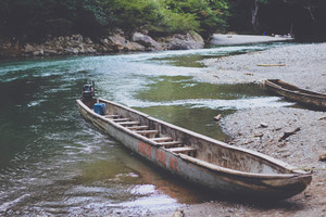 Old canoe on a river beach