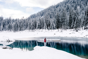 Swiss frozen and snowy nature with single man