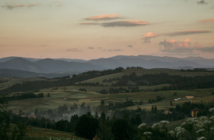 Carpathian mountains in sunset sky