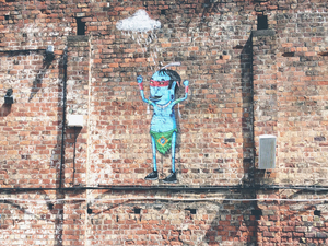Cartoon art piece on brick wall