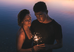 Couple holding fireworks