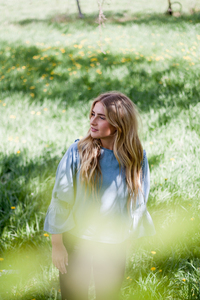 Blonde girl in flowery meadow