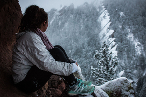 Hiking girl in snowy mountain