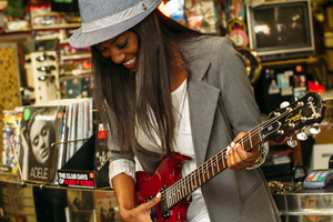 Girl is checking out the guitar