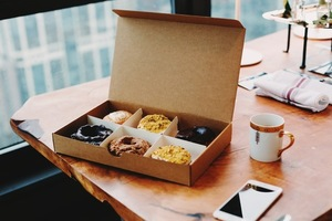 Box of donuts and cup of coffee