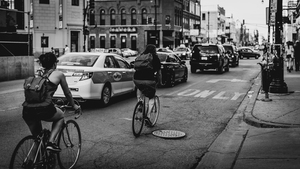 Chicago cyclists in black and white