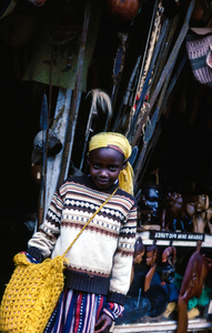 Child by market stall