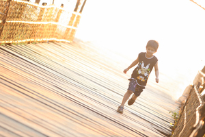 Child running across bridge