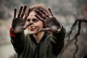 Girl with dirty palms