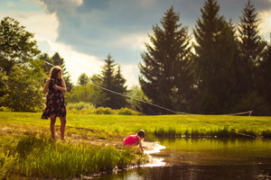Children fishing in pond