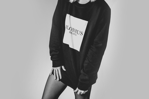 Girl in black and white sweatshirt