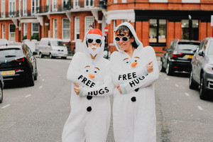 Girls in ''free hugs'' suits