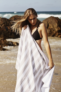 Girl with beach towel