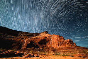Star trails covering cliff