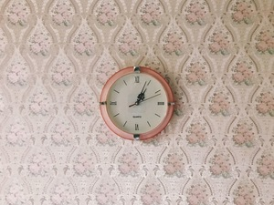 Clock on a floral wallpaper