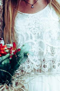 Close-up of a bride with a bouquet