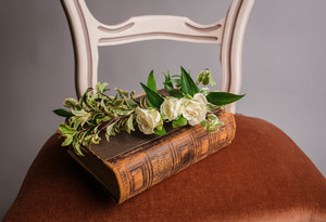 Book and flowers on chair