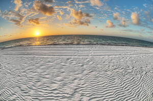Stripy sand beach and sunset