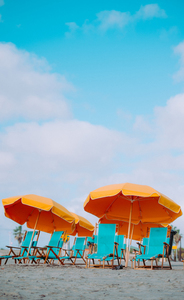 Yellow umbrellas and blue chairs