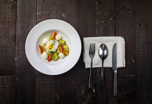 Egg with veggies on a plate