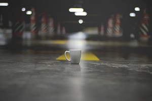 Coffee cup on the floor