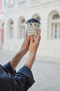 Coffee cup in woman's hands