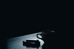 Coffee and cigarettes on table
