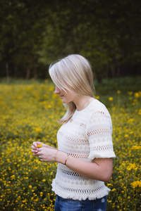 Blonde girl in flower field