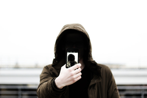 Hoodie man with his phone