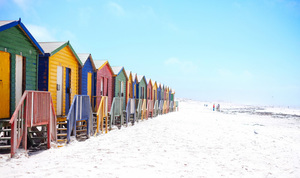 Colorful beach huts on beach