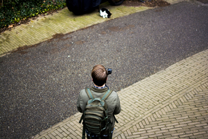 Man filming a cat