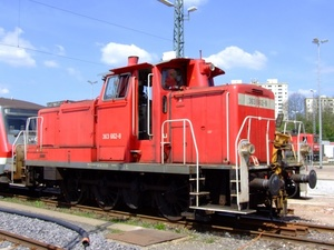 Red locomotive at the station