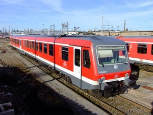 Red electric locomotive on the railway