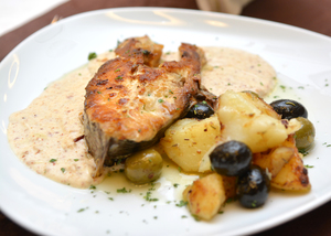 Salmon filet with potatoes and olives