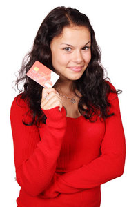 Smiling girl with credit card