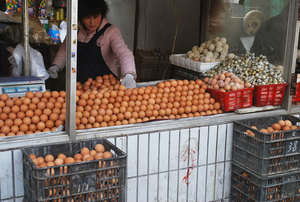 Displayed eggs on market stand