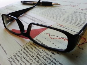 Newspaper under reading glasses