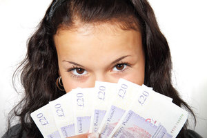 Charming girl showing money