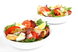 Salad in white bowls