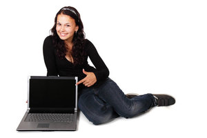 Girl sitting next to computer