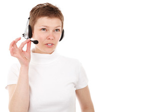 Woman with headset talking