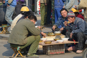 Workers eating on lunch break