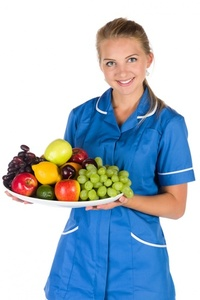 Nurse And A Bowl Of Fruit